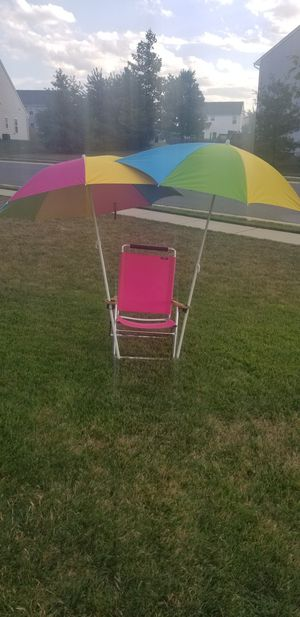 BEACH CHAIR AND TWO UMBRELLAS for Sale in Hagerstown, MD