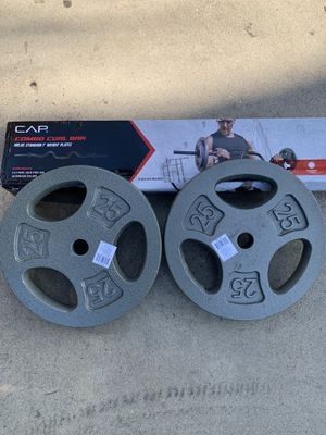Cap Two 25 pound weight plates plus Curl bar everything brand new for Sale in Santa Ana, CA