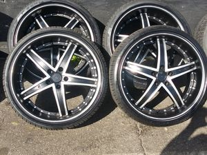 5/115 lug pattern. 20 inch rims black and silver will fit nissan / hondas and many 700 mounted and balanced for Sale in Mableton, GA
