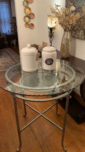 Tall kitchen table silver medallion design with glass topper for Sale in Clifton, NJ