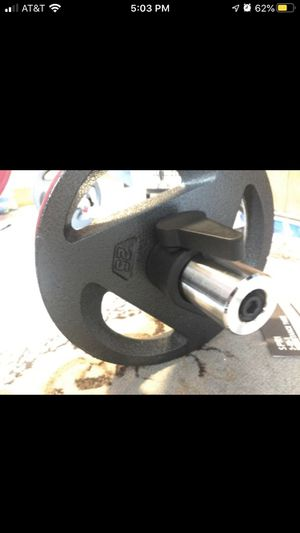 Olympic curl bar and 25lb plates with clamp style collars for Sale in Phoenix, AZ