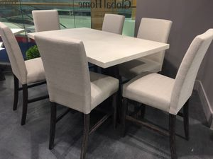 New real concrete top , bar height dining table 6 chairs, showroom floor sample for Sale in Durham, NC