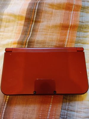 Shiny Red Nintendo new 3ds xl with 100 3ds games , ds , 2ds , 64gb sd for Sale in Los Angeles, CA
