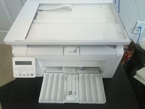 Hp laser printer and scanner, does wireless and wired lan and usb for Sale in Tampa, FL