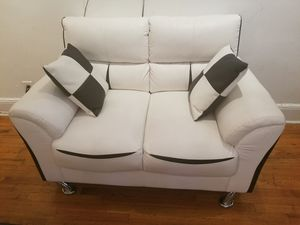 Small white leather couch with black accents for Sale in New York, NY