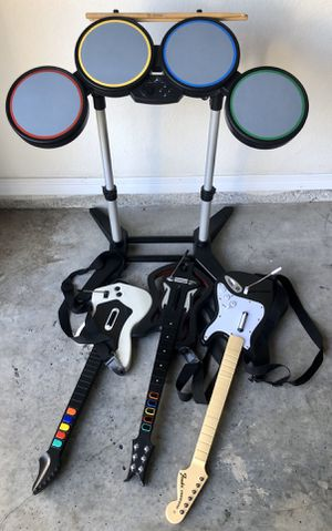 Rock band drums with three wireless guitars for Sale in Gainesville, FL