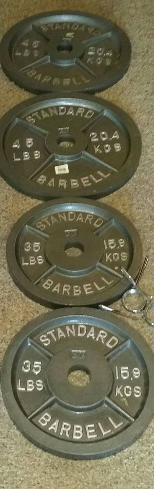 Olympic iron weights. Pair of 45s and 35s. Weight clips not included. for Sale in Coconut Creek, FL