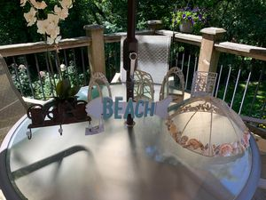 She'll food cover, beach hanger, heavy metal outdoor like candle holders, silk plant and one metal candle holder with neat designhanger, 3 heavy met for Sale in St. Charles, IL