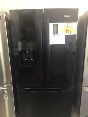 Refrigerator in black French doors New Whirlpool warranty for Sale in Oakland Park, FL