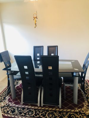 Glass dinning table with 6 chairs, just use 3 mouths. for Sale in Alexandria, VA