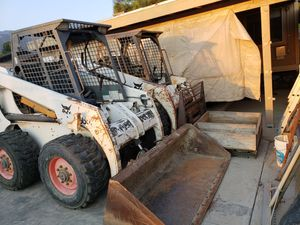 2 Bobcats with buckets backhoe and auger for Sale in Rancho Cucamonga, CA