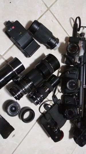 Camera's & lenses 2 Canon 1 Nikon & stand & extra for Sale in Bronx, NY