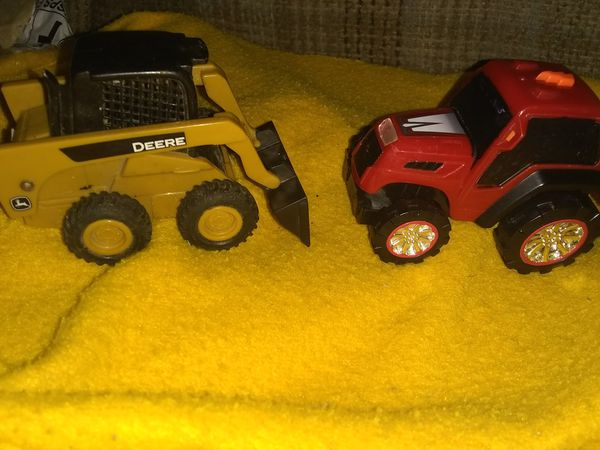 A John Deere mini front in loader & a road rippers tractor!