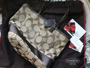 Genuine coach purse w/ charms & storage bag. excellent condition for Sale in Vidalia, GA