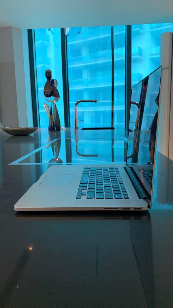 """Mid 2015 15"""" Retina Display MacBook Pro. 2.2 GHz Quad-Core Intel Core i7, 16 GB 1600 MHz DDR3, Intel Iris Pro 1536 MB"""