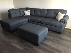 """New in box blue grey sectional sofa ottoman with storage included// reversible chaise 107""""x75"""" for Sale in Los Angeles, CA"""
