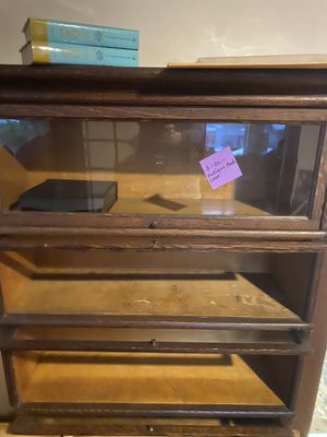 Antique cabinet with glass drop down shelf covers for Sale in San Diego, CA