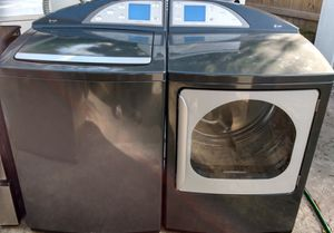 BEAUTIFUL GE PROFILE SUPER CAPACITY WASHER DRYER SET WITH STAINLESS STEEL TUB AND NO AGITATOR for Sale in West Palm Beach, FL