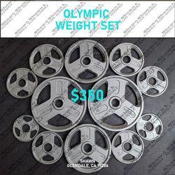 OLYMPIC WEIGHT SET- 165 LBS (2× 35LBS - 2× 25LBS - 2× 10LBS - 4× 5LBS - 2× 2.5LBS) for Sale in Glendale,  CA