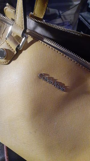 Yellow Calvin Klein purse for sale for Sale in Pleasant Hill, IA