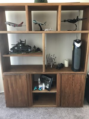 Oak wall unit, very heavy, very strong, adjustable shelves. Need at lease 3 person to pick it up. Solid like a rock. for Sale in Baltimore, MD