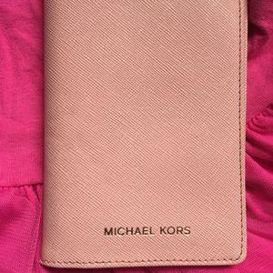 Michael Korse Passport Wallet (pink). for Sale in Garden Grove, CA
