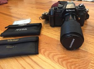 Nikon 35mm film camera - vintage w bag and filters for Sale in Chicago, IL