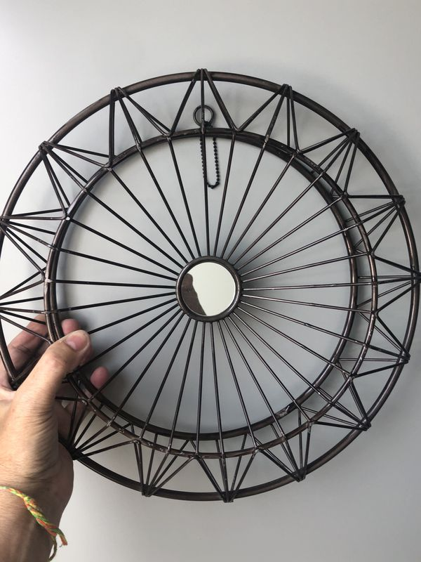 Black Decorative Wall Circle with a mirror in center