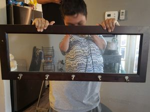 Wall mirror with hooks to hang towels, clothes etc. for Sale in Las Vegas, NV