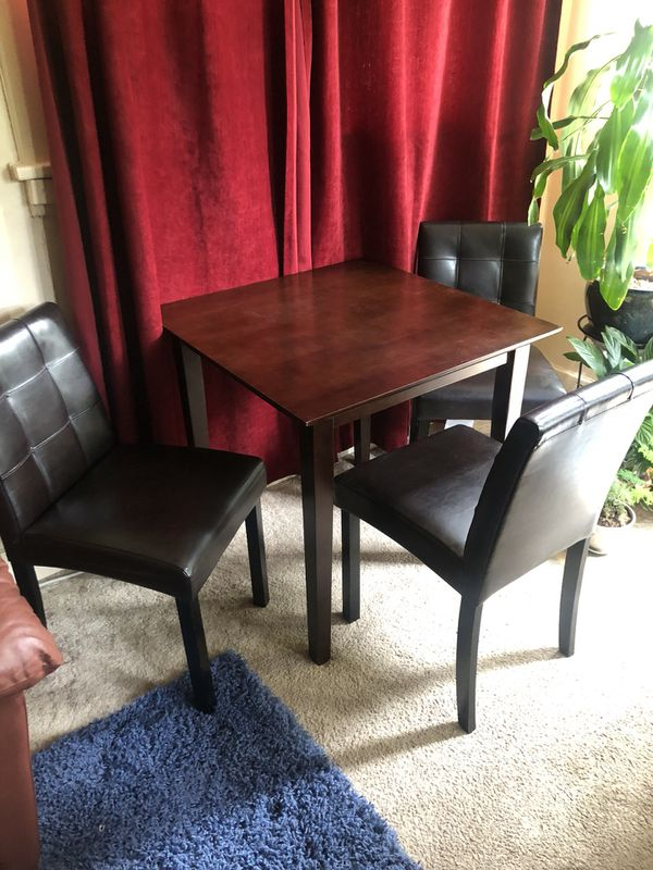 Table and five leather chairs