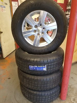 """Set of 4 - 18"""" Alloy wheels with new tires for Chevy traverse lug pattern 6x132. for Sale in St. Louis, MO"""