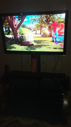 TV and TV stand for Sale in Grand Rapids, MI