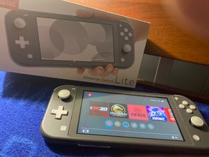 Nintendo switch lite + games and a micro Sd card for Sale in Springfield, VA