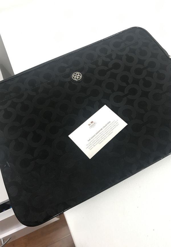 Coach Signature collection laptop zip-up