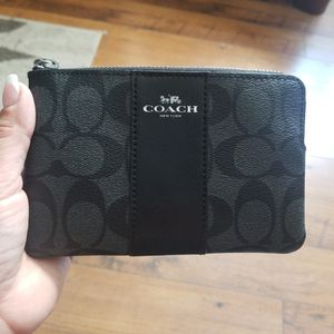 COACH Corner Zip Wristlet In Signature Coated Canvas With Leather Stripe for Sale in Los Angeles, CA