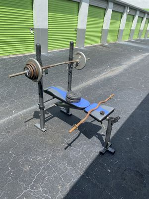 Adjustable bench with 105lbs of weights for Sale in Davie, FL
