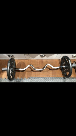 Olympic curling super bar/Barbell, fast locking Olympic style collars, and pair of 35lbs Olympic plates/ weights for Sale in San Gabriel, CA