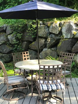 Outdoor patio furniture. Table, chairs, and umbrella. for Sale in Everett, WA