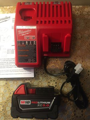 Milwaukee. M12/M18 Lithium Ion Multi-Voltage Charger and XC 5.0Ah Battery Pack. for Sale in Brooklyn, NY