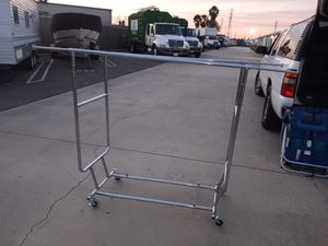 Used Double Clothing Rack With Wheels for Sale in Anaheim, CA