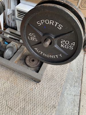 Weight set including bar for Sale in Apopka, FL