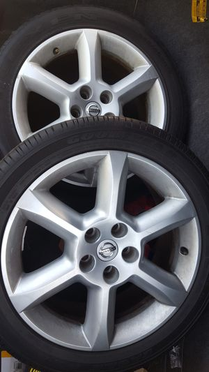 2 x 18 inch Nissan rims and tires for Sale in Dublin, OH