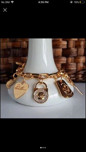 Mk Michael kors charm bracelet gold tone heart key padlock women's jewelry for Sale in Spencerville, MD