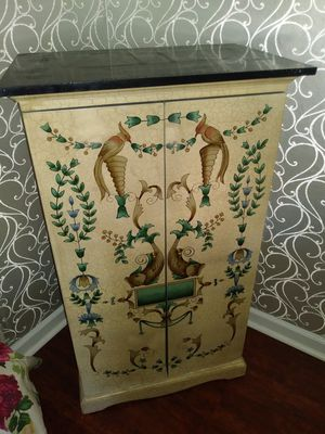 Oriental style 2 door cabinet with storage shelves for sale for Sale in St. Louis, MO