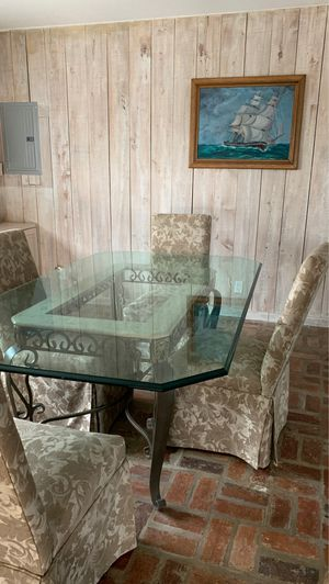 Glass top dining table with 6 chairs for Sale in Dania Beach, FL