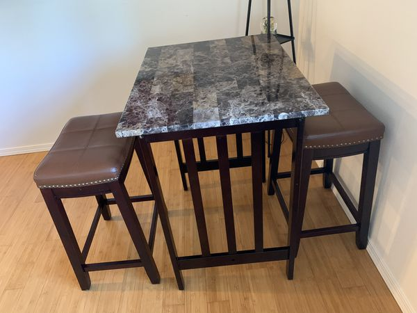 Small high counter table and two stools