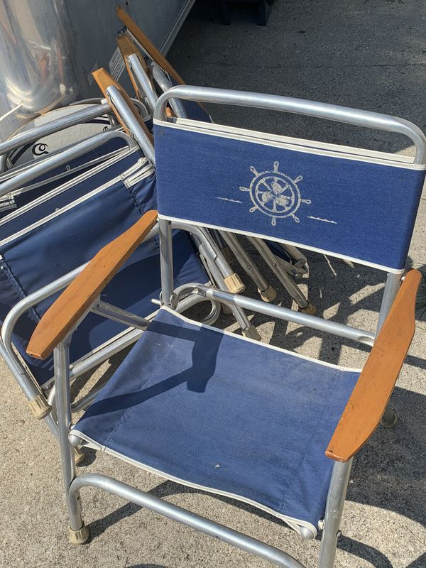 4 low profile folding chairs with matching table for the back of a boat