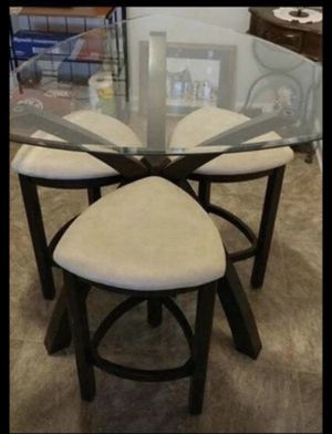 Kitchen Table and Stols Glass top, counter height, dark brown wood legs, stools cushioned off white.Pick up in Mebane NC for Sale in Mebane, NC