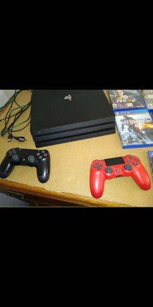 Ps4 pro with double controllers and extra games for Sale in Denver, CO
