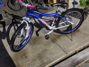 """Like new,use a few times,24"""" women Genesis 24 whirl wind,disk brake,front shocks only $220 for Sale in Lincoln, RI"""